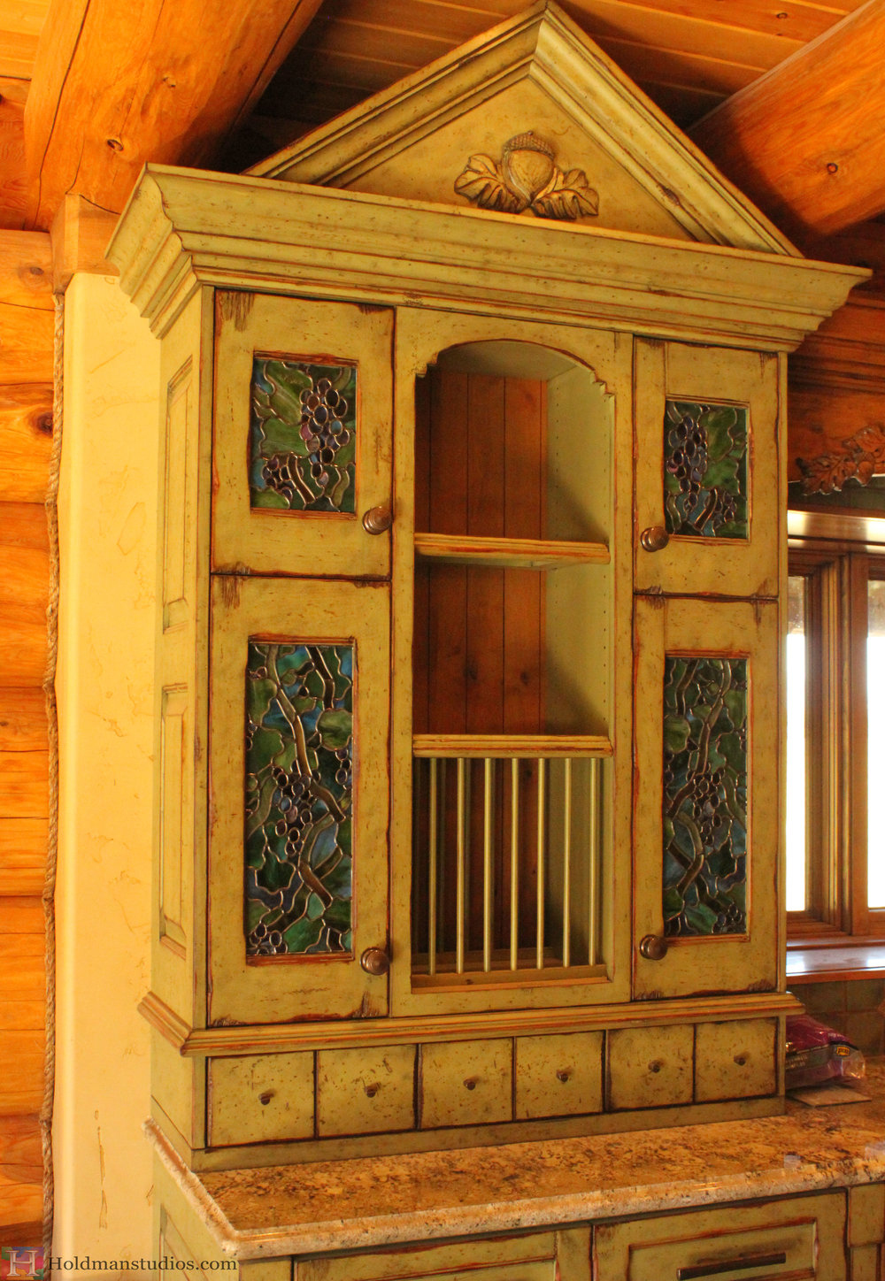 unfinished kitchen cabinet with stained glass door windows of grape vines created by artists under the direction of tom holdman at holdman studios