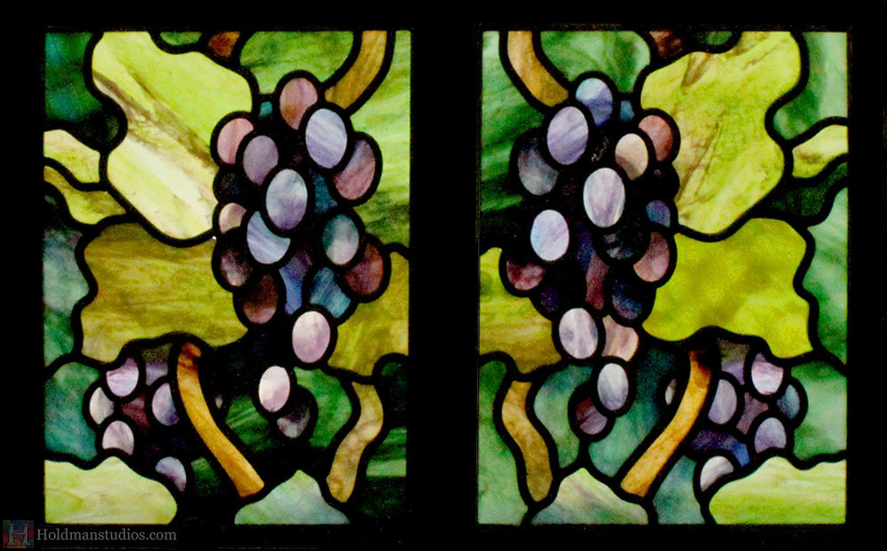 stained glass window of vines leaves and grapes created by artists under the direction of tom holdman at holdman studios