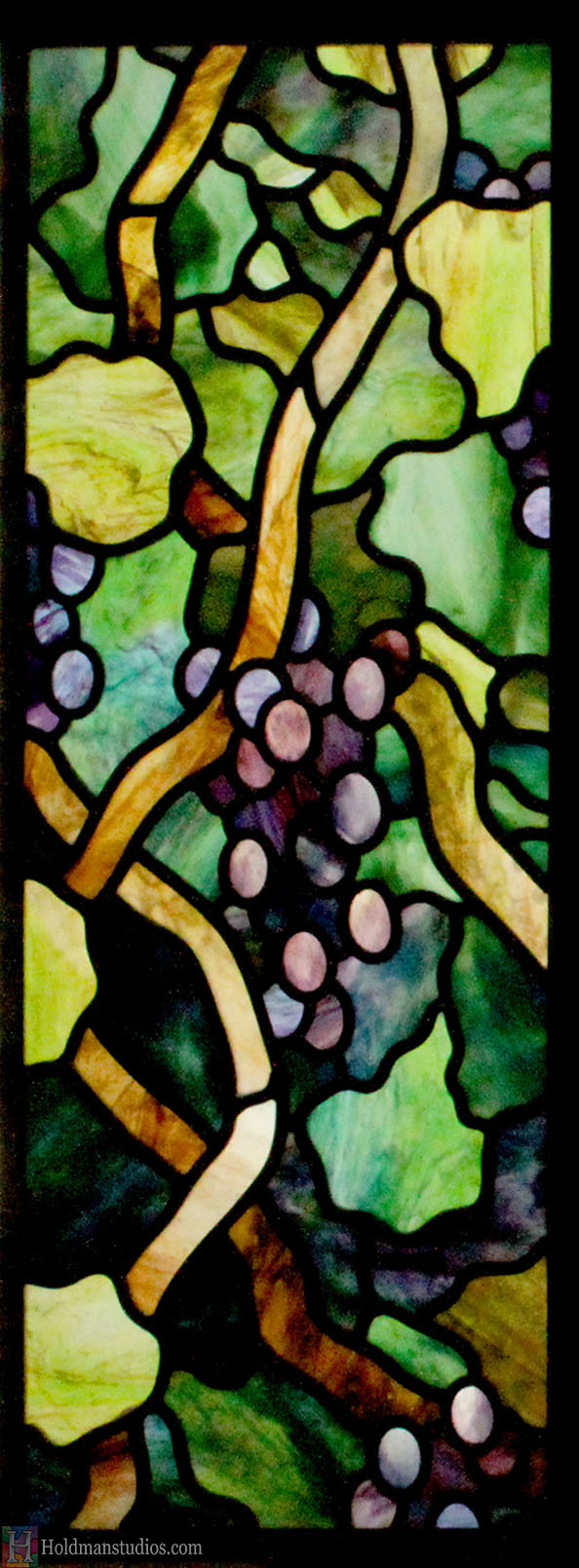 stained glass kitchen cabinet window of vines leaves blossoms and grapes created by artists under the direction of tom holdman at holdman studios