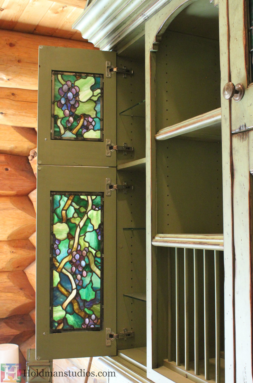 stained glass kitchen cabinet door windows of vines leaves blossoms and grapes created by artists under the direction of tom holdman at holdman studios