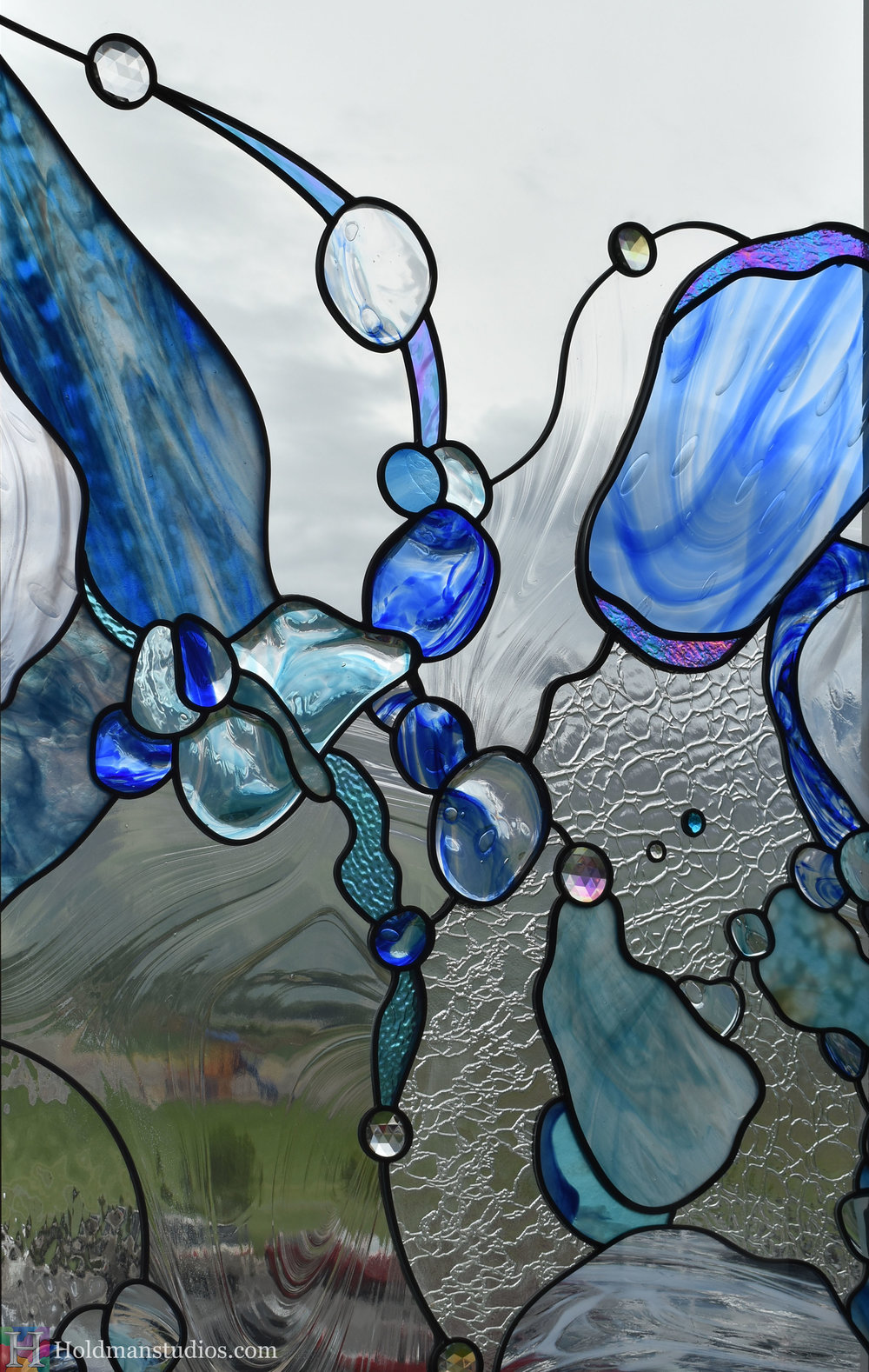holdman-studios-hand-blown-stained-glass-window-springville-clyde-rec-center-slash-and-wave-cropped2.jpg