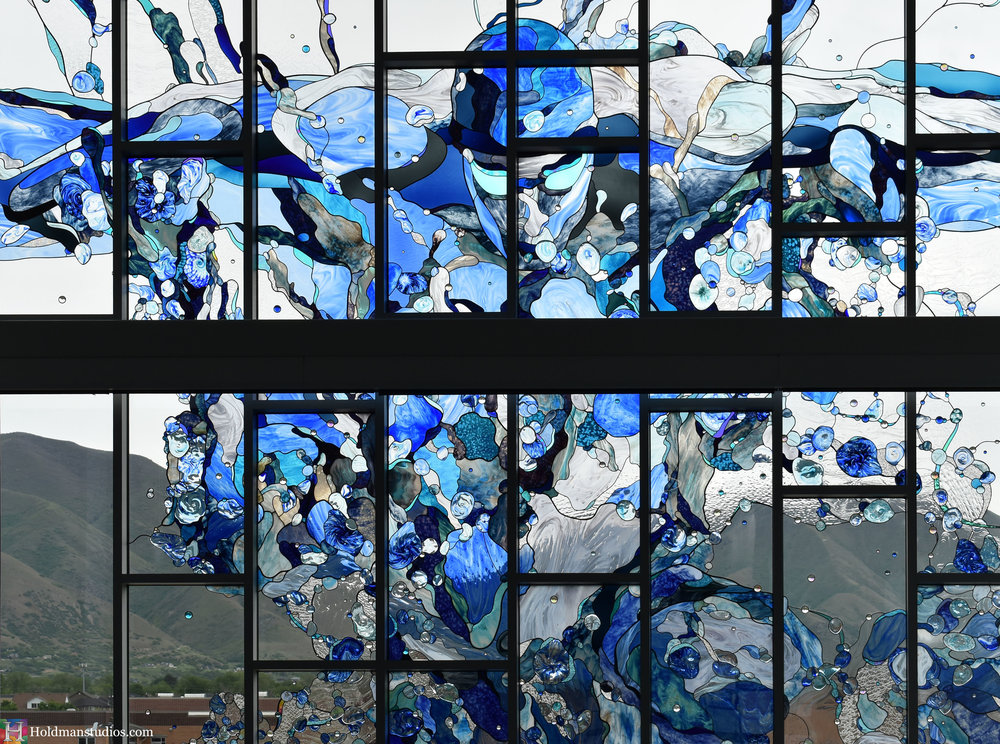 holdman-studios-hand-blown-stained-glass-window-springville-clyde-rec-center-slash-and-wave-swimmer.jpg
