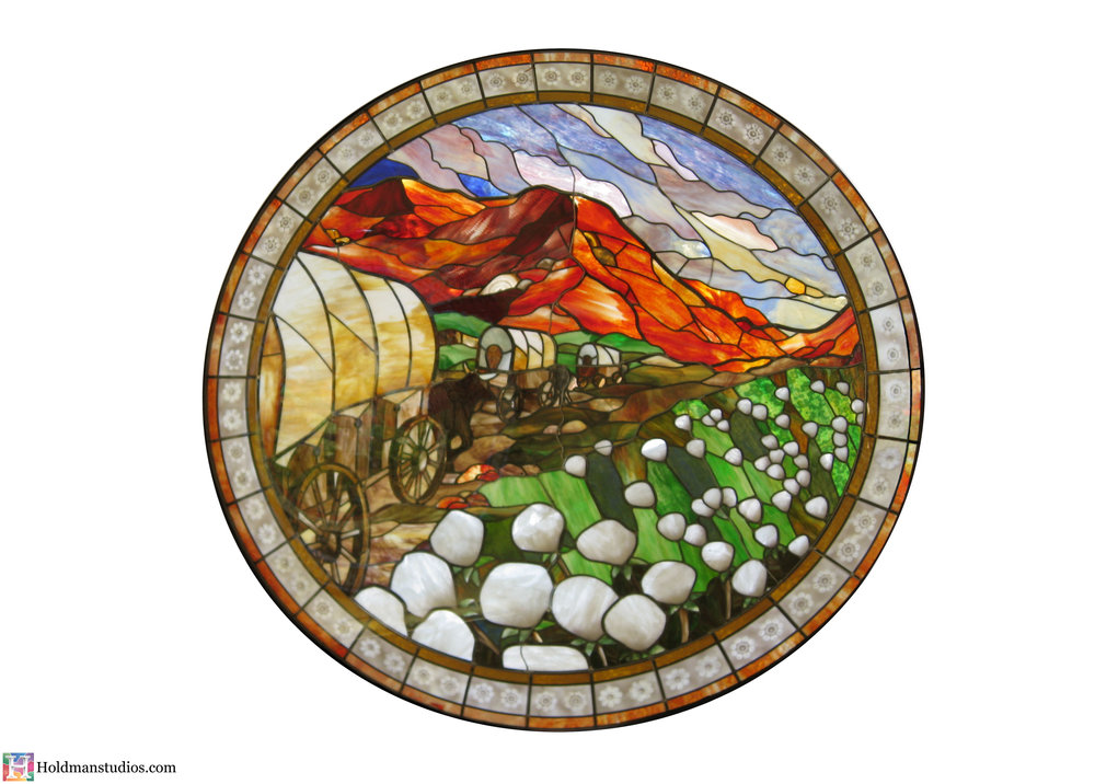 holdman-studios-stained-glass-window-st-george-town-square-mountains-trees-flowers-sky-clouds-pioneer-wagon-train.jpg