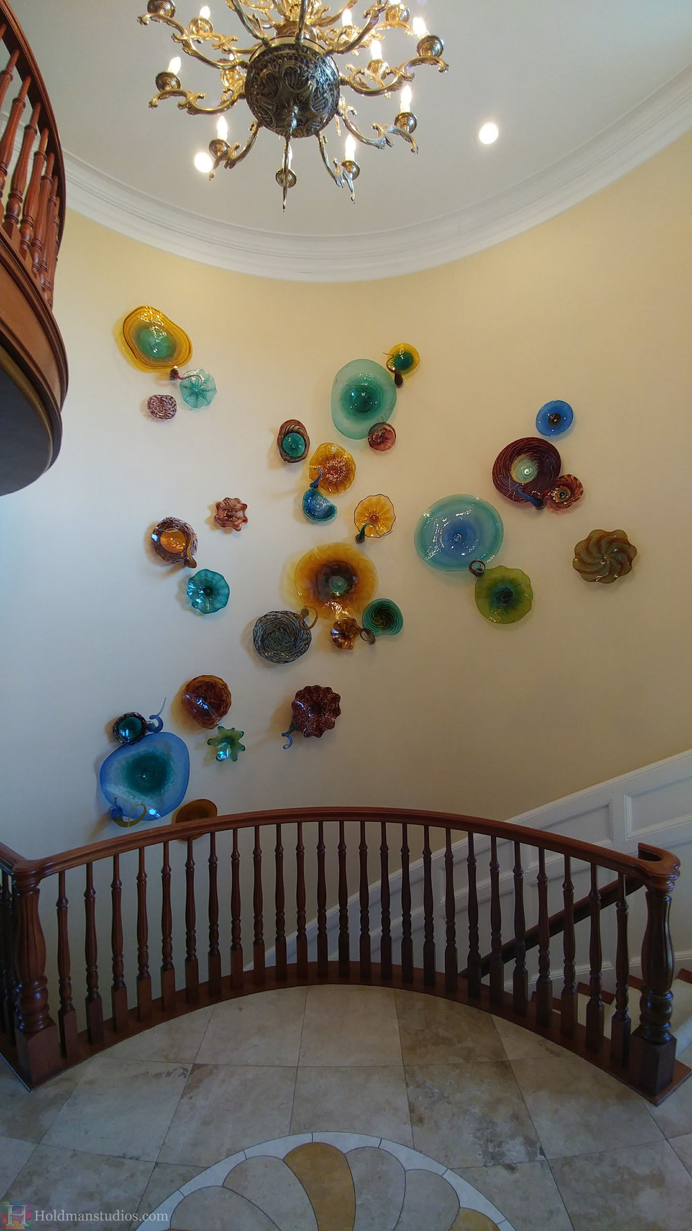 holdman-studios-hand-blown-glass-platters-bowls-tendrils-stair-wall-display.jpg