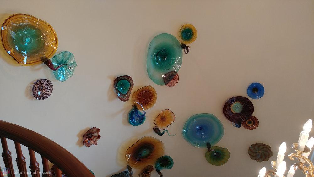 holdman-studios-hand-blown-glass-platters-bowls-tendrils-stair-wall-display-closeup.jpg