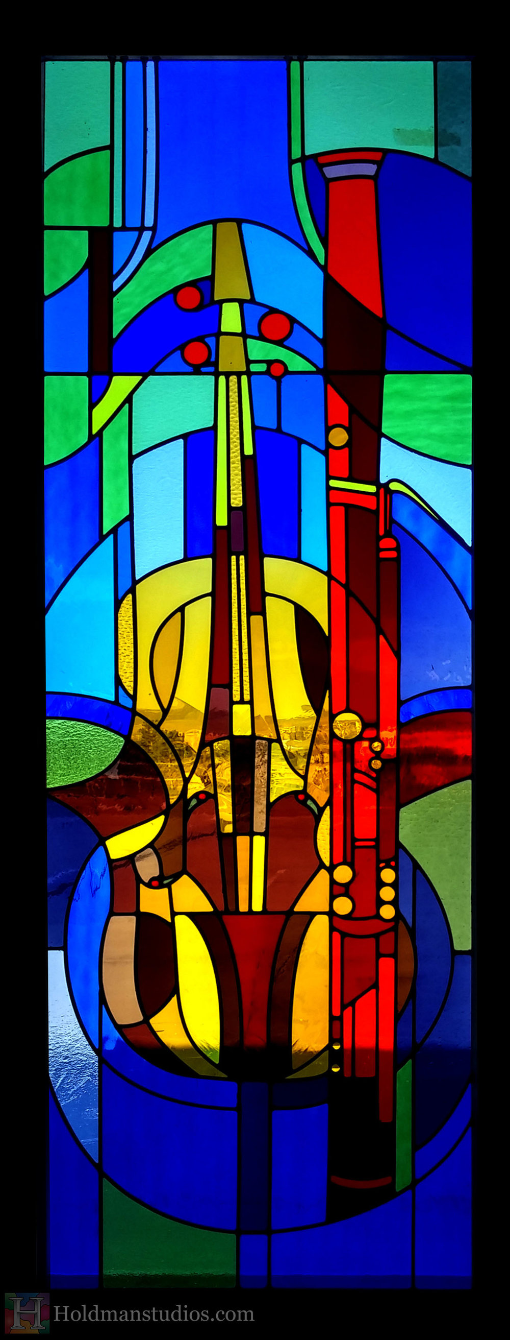 holdman-studios-stained-glass-window-musical-instuments-violin-viola-bassoon-gometric-patterns.jpg