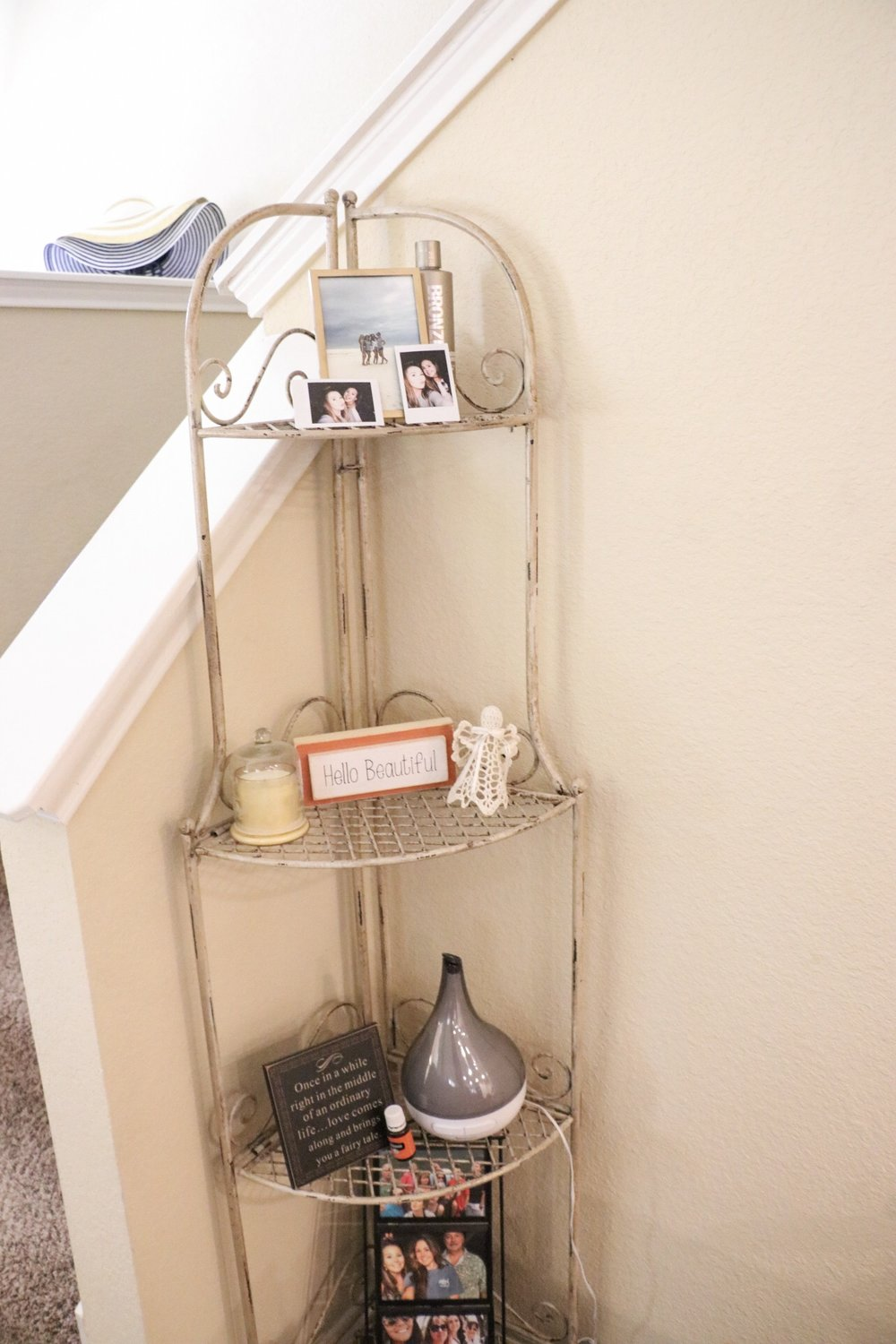 This stand by our stairway is from Hobby Lobby as well! We placed some knick knacks and photos. Mostly from pier one, and Hobby Lobby!