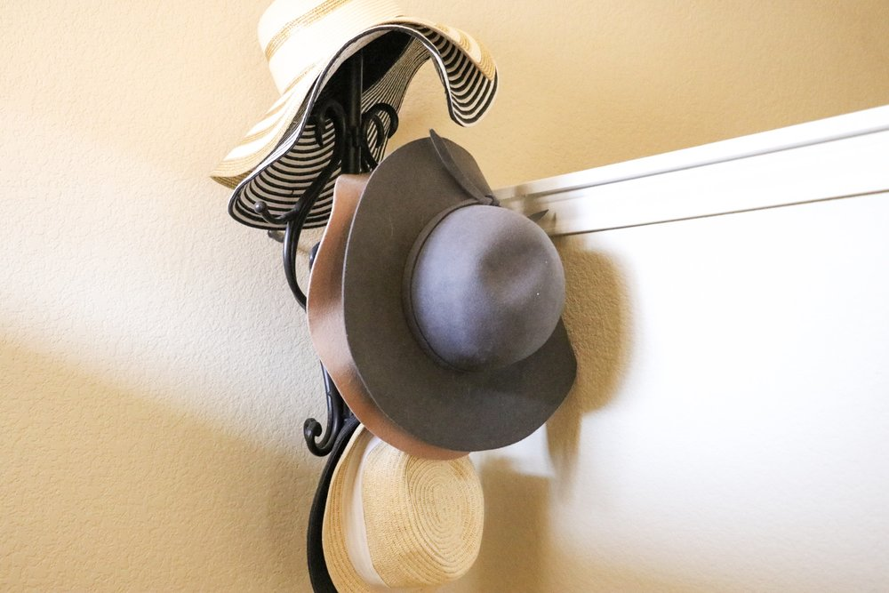 I have had this coat rack forever. When we moved, I put it right by the front door and decided to put my hats on it! I love the way it looks. Brings character and a girly feel to the area!