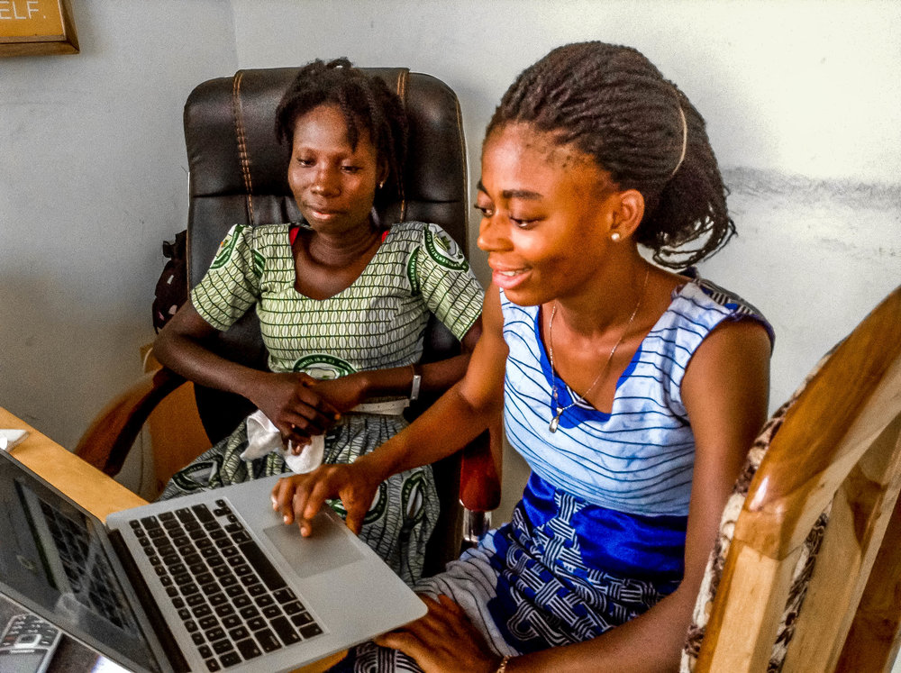 Martha and Tina are researching on what they will be teaching during litercy club.jpg