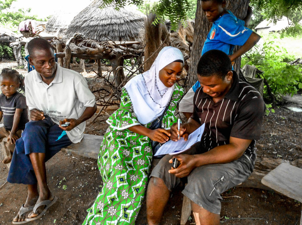 Sumaya helped a man of yapala community who showed interest in learning how to write to write -2.jpg