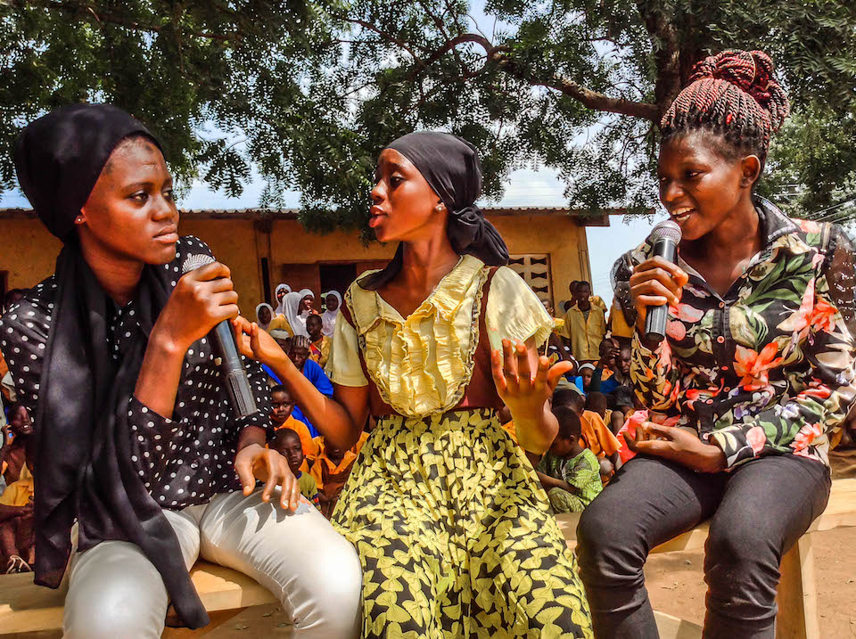 Charity acting as a mother together with Fatima and Shuckura as her children advising them on peer influence during the sensitisation program at Taha community copy.jpg