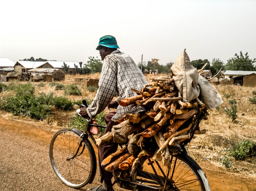 A parent at Ticheli community on his way from the farm.jpg