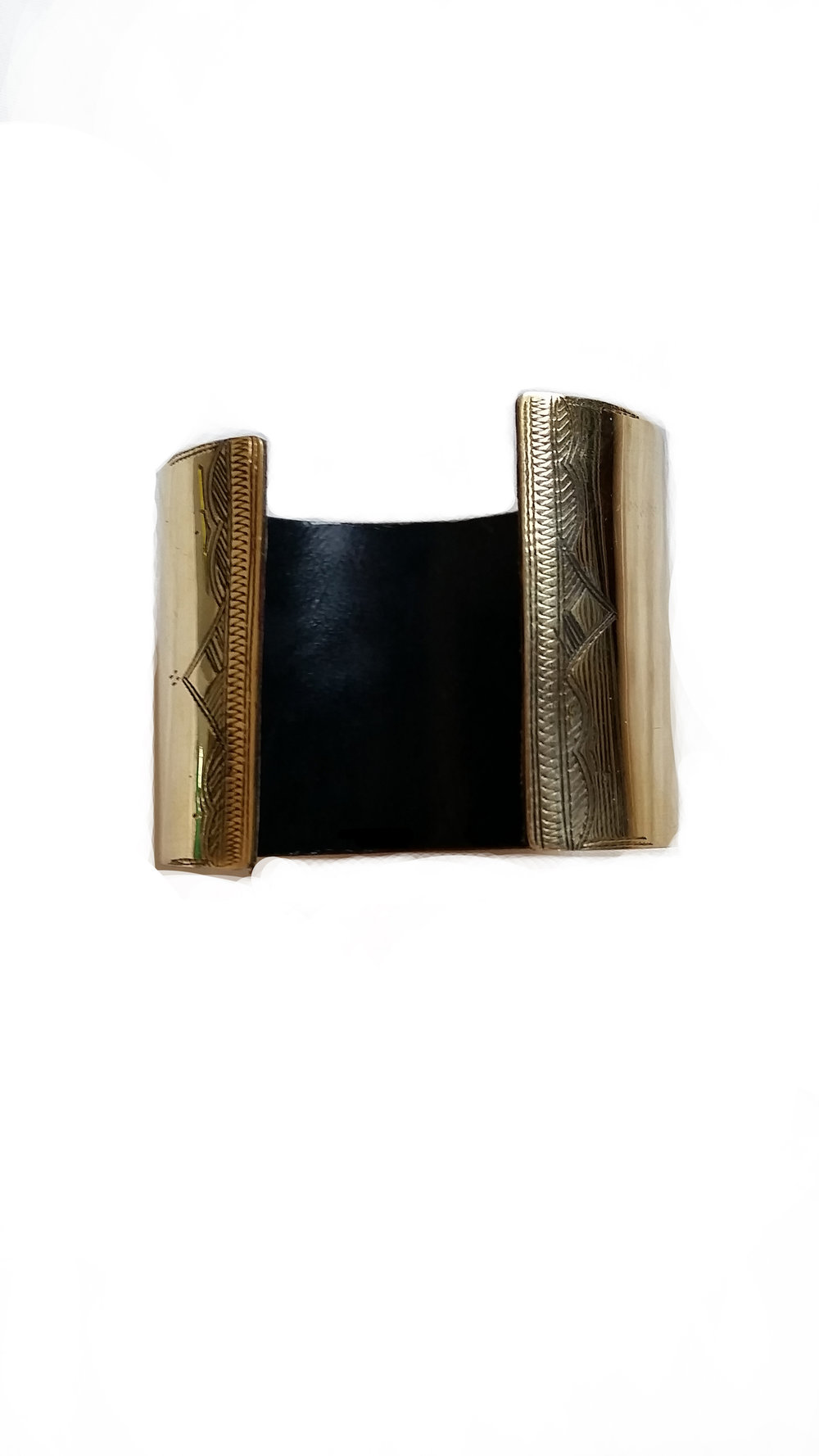 POLISHED BRONZE & LEATHER CUFF Polished bronze, etched cuff fitted with handmade leather.