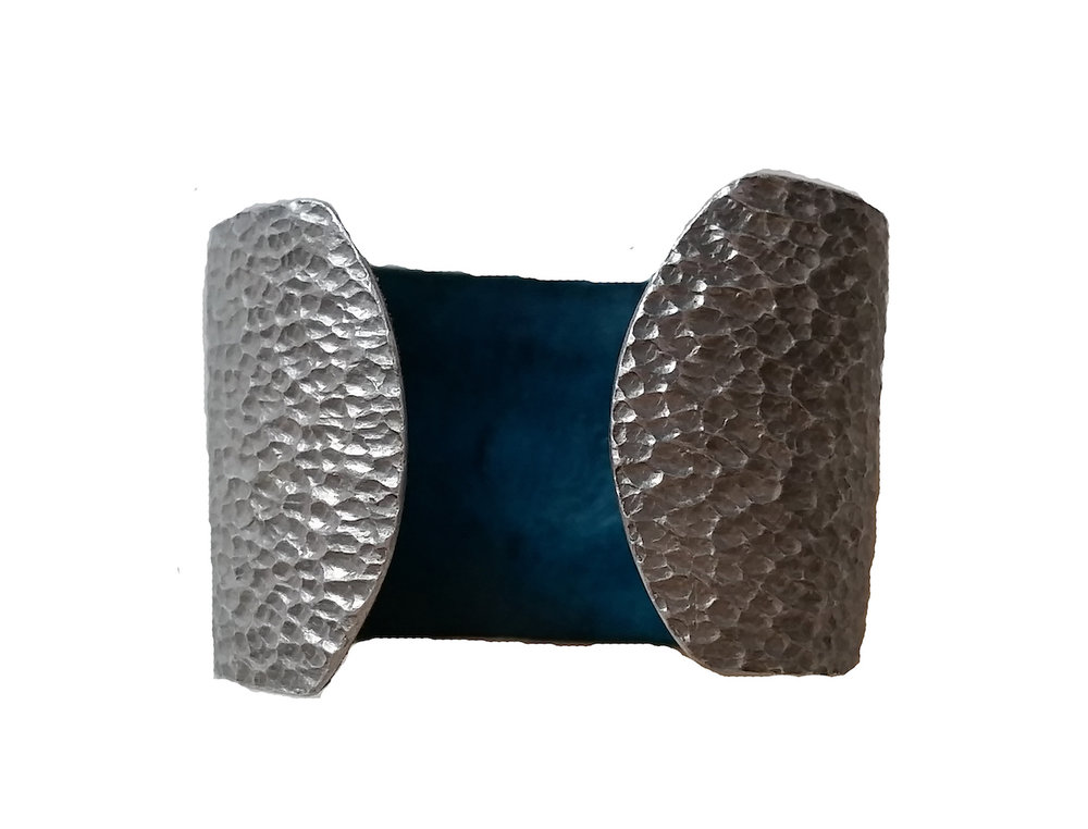 HAMMERED METAL & LEATHER CUFF   Hammered aluminium, copper and bronze cuffs fitted with handmade leather.