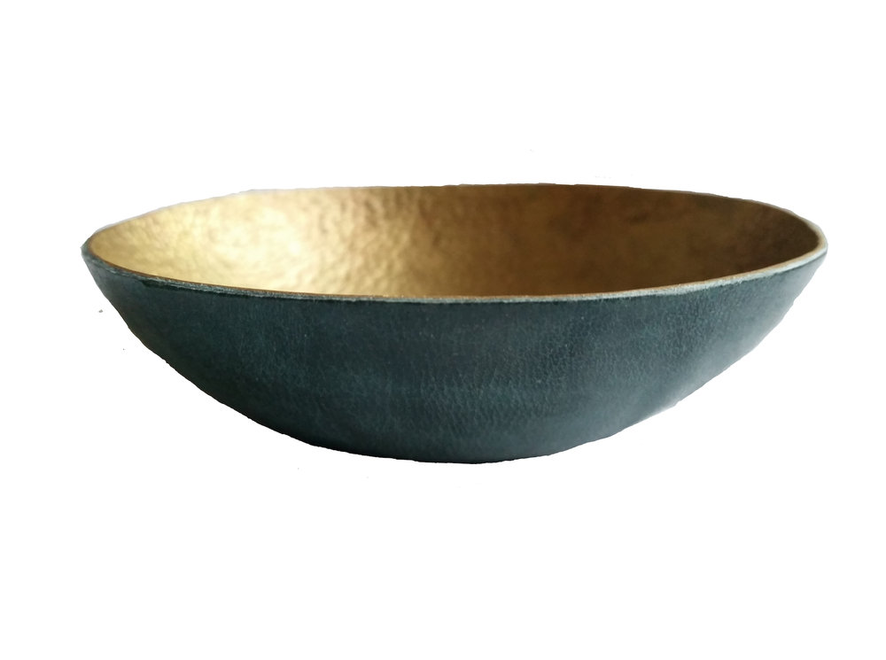HAMMERED METAL & LEATHER BOWLS Hammered aluminium, copper and bronze bowls covered in handmade leather.