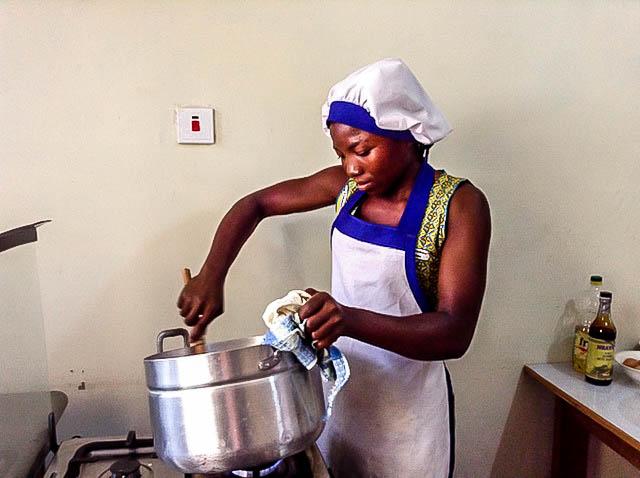 Zeinab in cookery class stiring stew.jpg