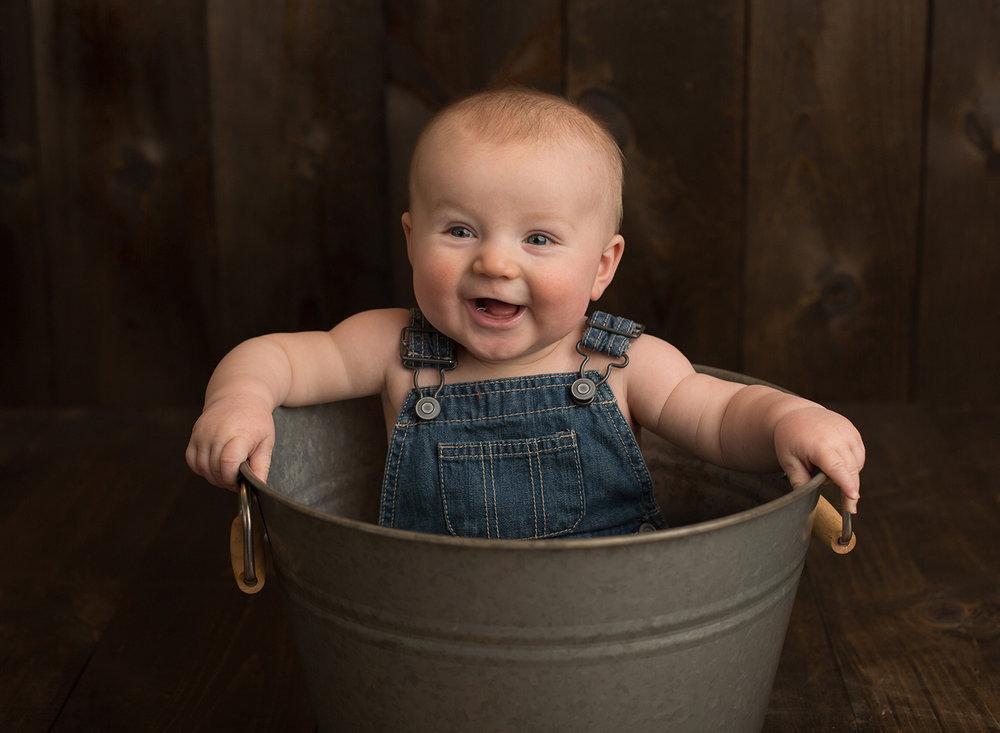 baby in bucket cute baby pictures gardner kansas portrait studio