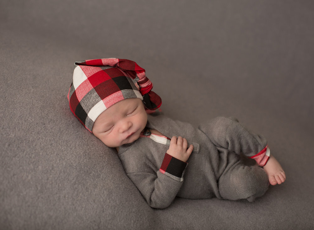 newborn boy wearing pj's