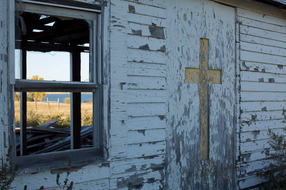 "This is the old church on the Standing Rock Sioux reservation.   This church brings stories to my head of the church on my own reservation. My grandmother  JoAnn  has told me the story many times, of my great great grandmother Clara Riggs going to see the medicine woman, who was forced to live isolated away from the rest of the tribe. One day Clara took the medicine woman to the white mans church for the first time. After the Catholic church service, Clara asked what she thought of it. The medicine woman replied:  ""the white mans god is stuck in the stained glass windows"".   You can see our religion through the church windows and walls that are no longer. You can see the river that people who live the ways of this church tried to destroy with oil.   Peace and balance is our religion. The river is our religion, we stand on the bridge above it and are met with violence as they protect their religion, money.   I will forever remember this story, and I will tell my grandchildren this story, I will teach them to love the earth and to not take more than they need from her and to be gentle with her people."
