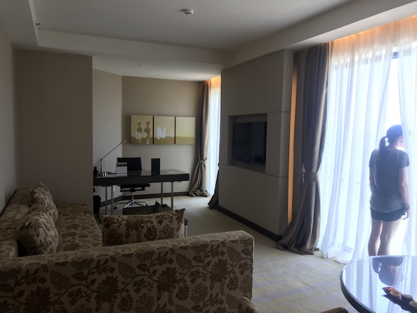 We paid $55 + 7,000 Starpoints nightly and got upgrade to an executive suite with this ocean-view living room at the Sheraton Nha Trang.