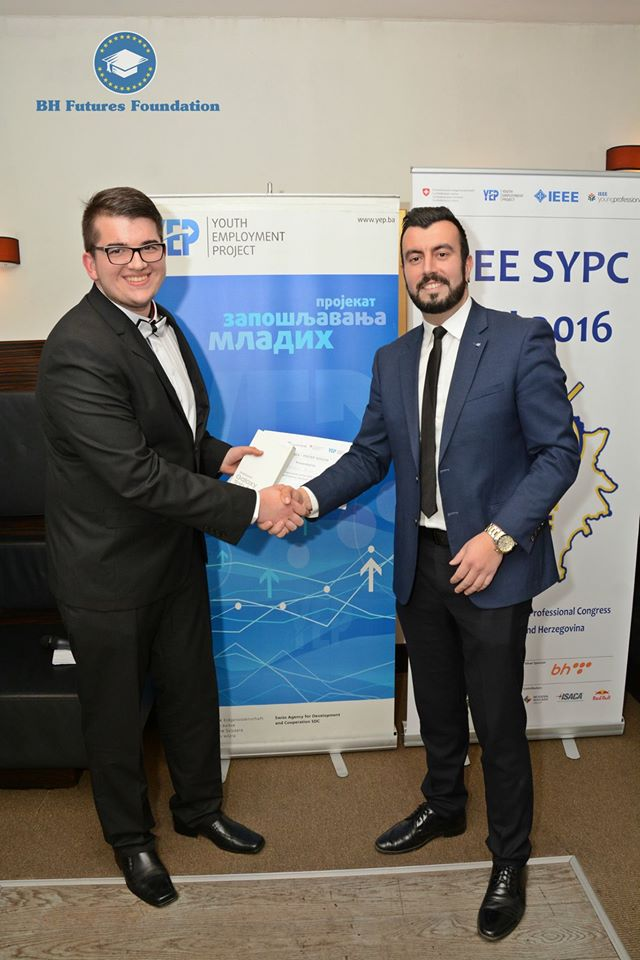 Dalibor Djumic receiving the 1st place award from Bosnia & Herzegovina Futures Foundation Founder & Chair Dr. Edhem (Eddie) Custovic.