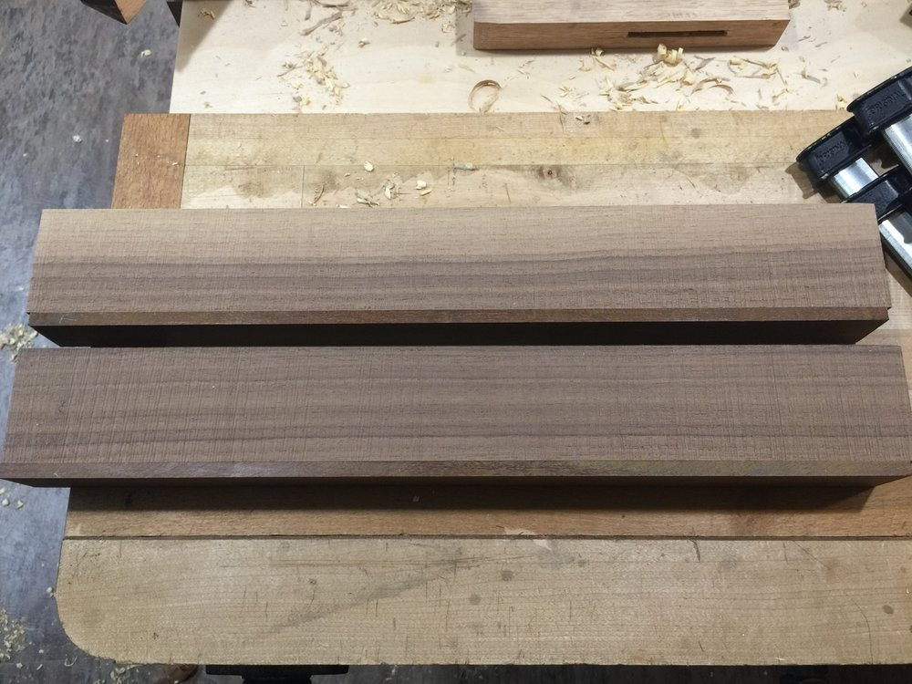 Had a few minutes today to get started on the razee style jack plane.  One of these blocks will form the body, the other will be ripped in two and used as the sides. I've given some thought to the grain orientation as one of the blocks is half sap wood and the other is darker walnut. I feel the sap wood is visually interesting, i think I'll use it for the sides.