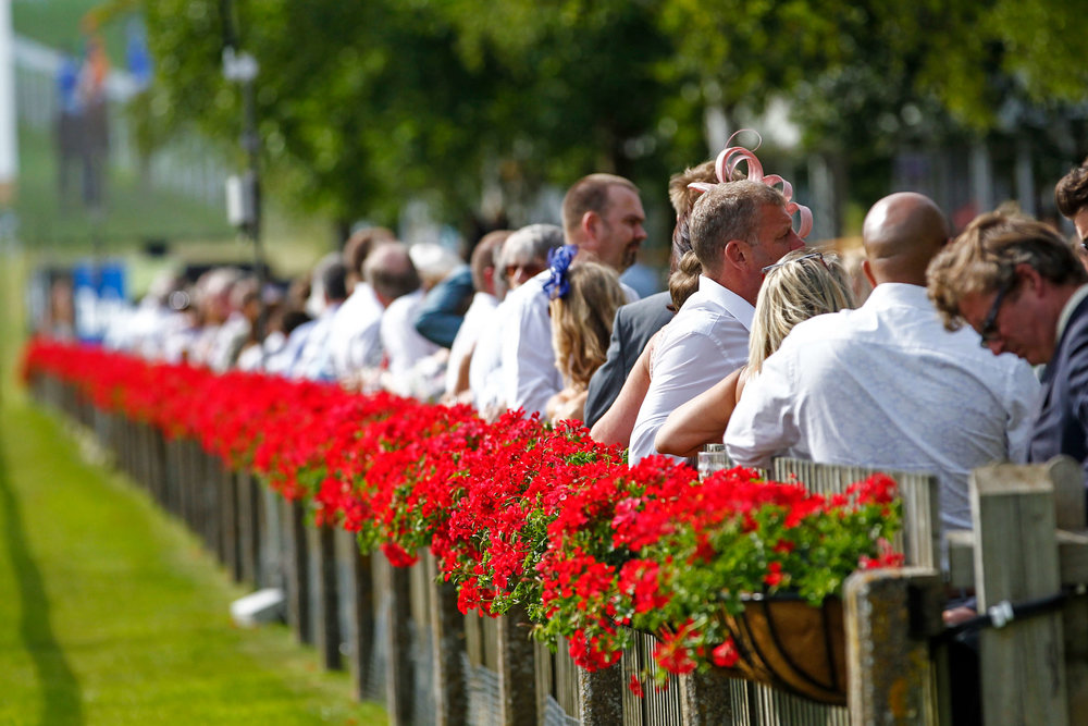 Racegoers-at-the-heart-of-the-action-at-the-Trackside-Pavilions-during-the-Moet-and-Chandon-July-Festival-c-Newmarket-Racecourses.jpg