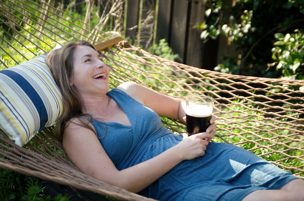 In her free time, Brie enjoys relaxing with a cold Guinness in her home foodscape. Photo Credit: Elizabeth Galecke