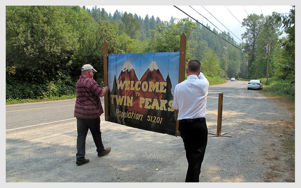 The Welcome to Twin Peaks sign, mounted by the city in the approximate location seen in the original show's opening credits, with real Mount Si in the background, has been variously hit by cars, stolen and finally removed.