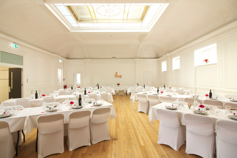The top floor wedding party space at Green Rooms Hotel with an original art deco sky light.