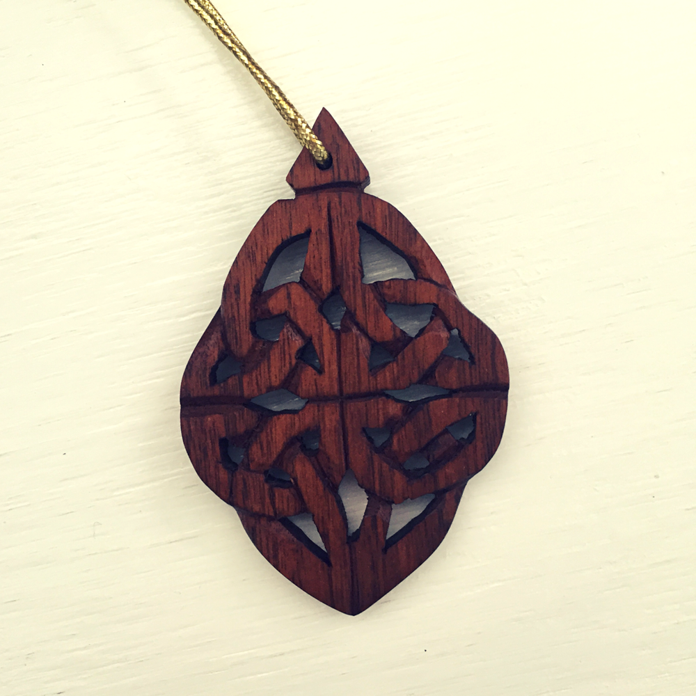 A hand-carved Celtic knot, a gift from March's Celtic Spirituality Retreat