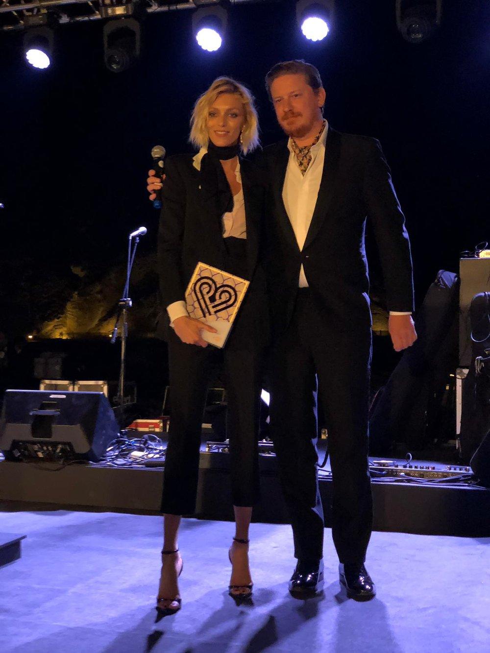 Filip Niedenthal Editor in Chief Vogue Poland presents award to Anja Rubik.jpeg