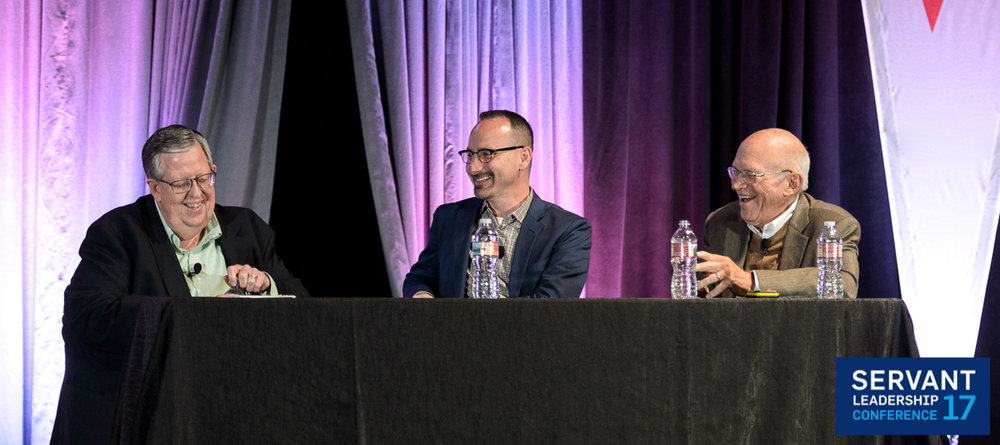 """Art Barter, Michael Tatelbame, and Ken Blanchard on stage at the 2017 Servant Leadership Conference """"The Music of Servant Leadership"""" during a Q&A."""