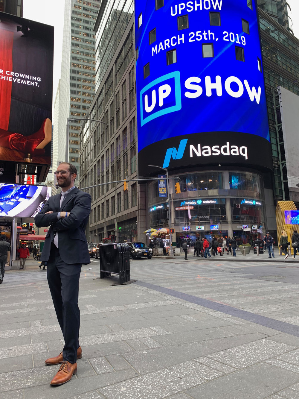 The UPshow logo displayed proudly in Time Square.