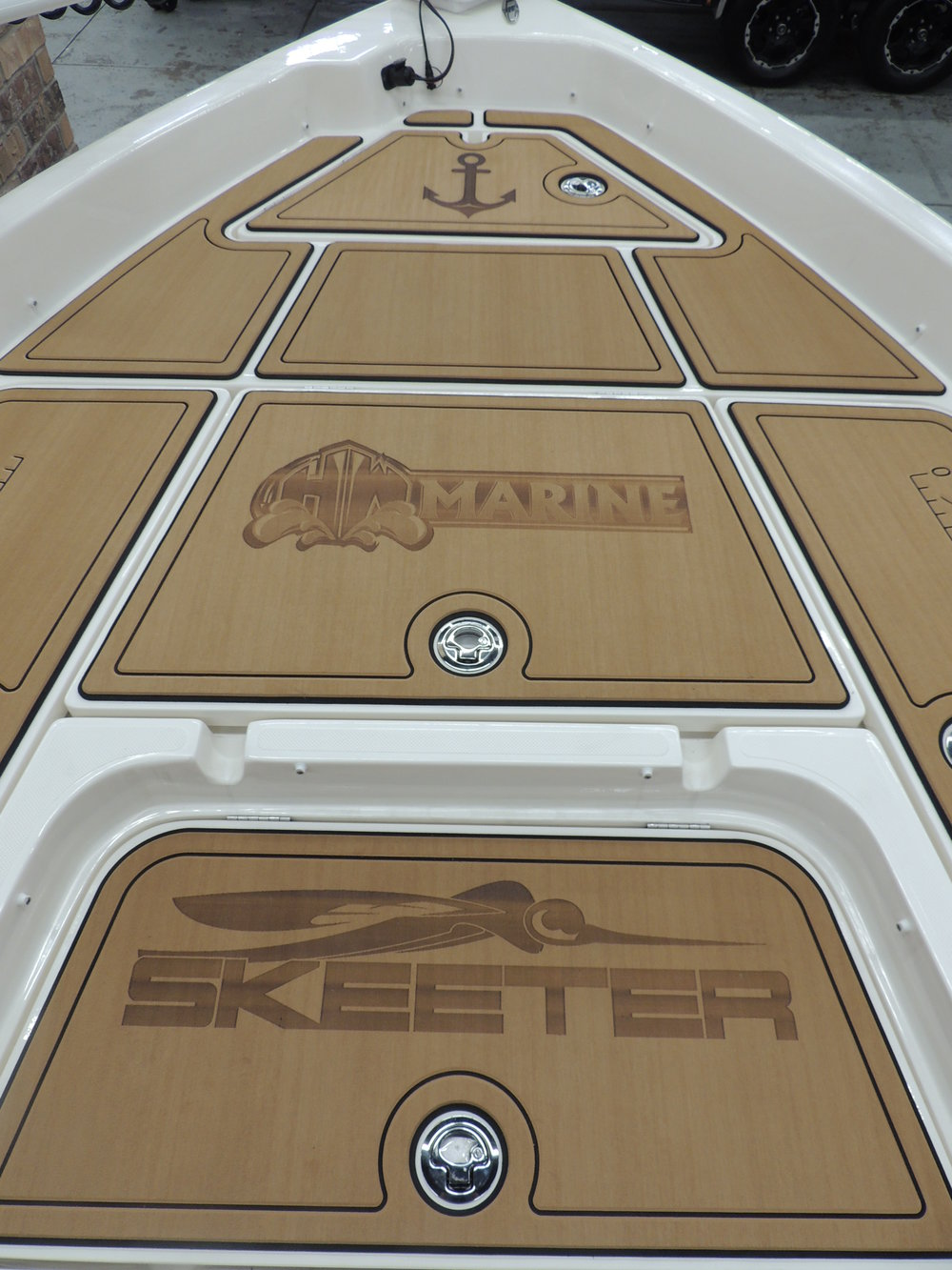 Close up detail of the laser logos on the front deck.  (Manufacturer logo used with permission)