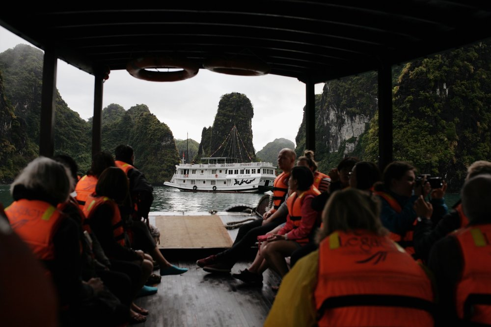 taking a small boat over to walk inside a cave