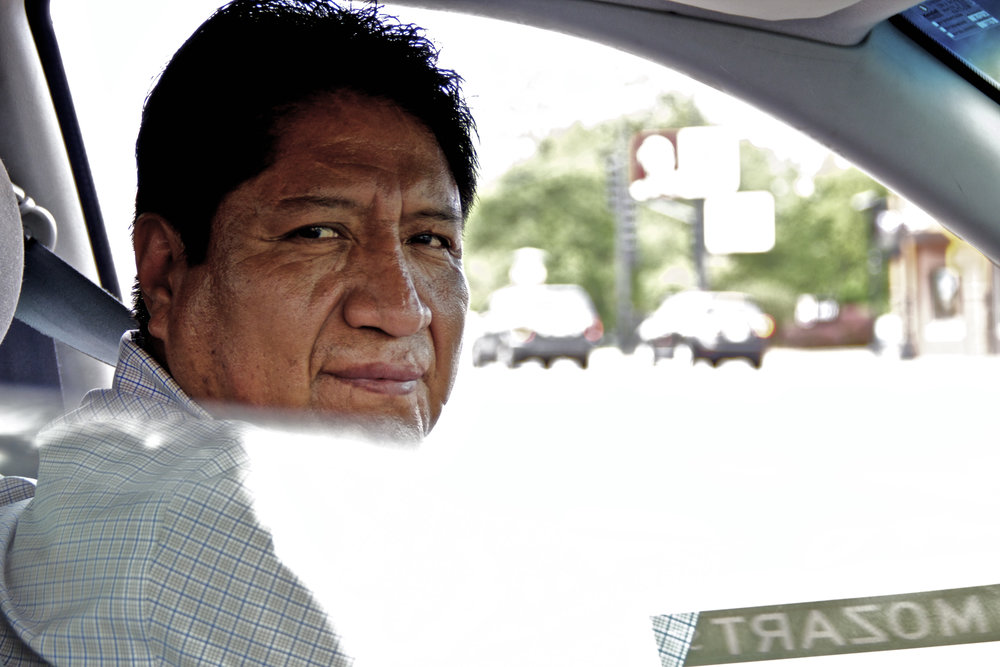 "He saw me taking someone else's photo and pulled up to the curb. He waited until I finished and honked lightly.  ""Your photo too?"" I asked and he nodded. ""Speak Spanish?"" he asked after I'd taken a couple shots. ""Not really, lo siento,"" I said and he sighed and turned onto the road."
