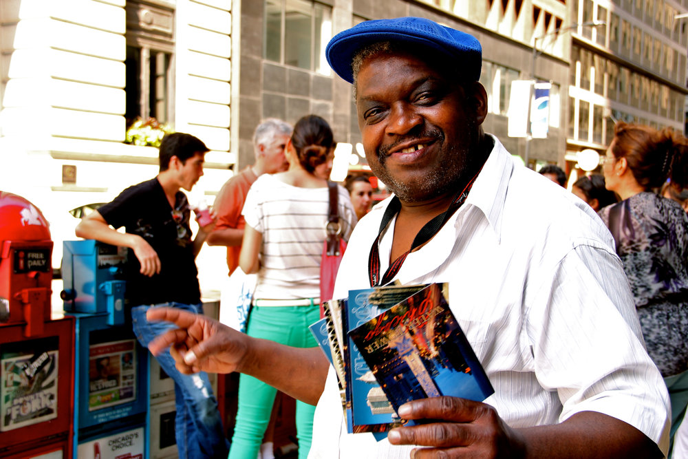 "He was peddling postcards to tourists just outside the Willis Tower entrance. ""They're for the homeless,"" he told each family.     I gave him some dimes from the bottom of my purse and he shook my hand.      ""That's bullshit, dude."" A man who'd asked for money ten minutes earlier crossed the street to guilt me. ""You give him that, he's gonna spend it right on drugs.""      ""Sorry."" I muttered, tucking the postcard away.      ""Bullshit,"" the man spat again. ""He does this every day. Bullshit."""