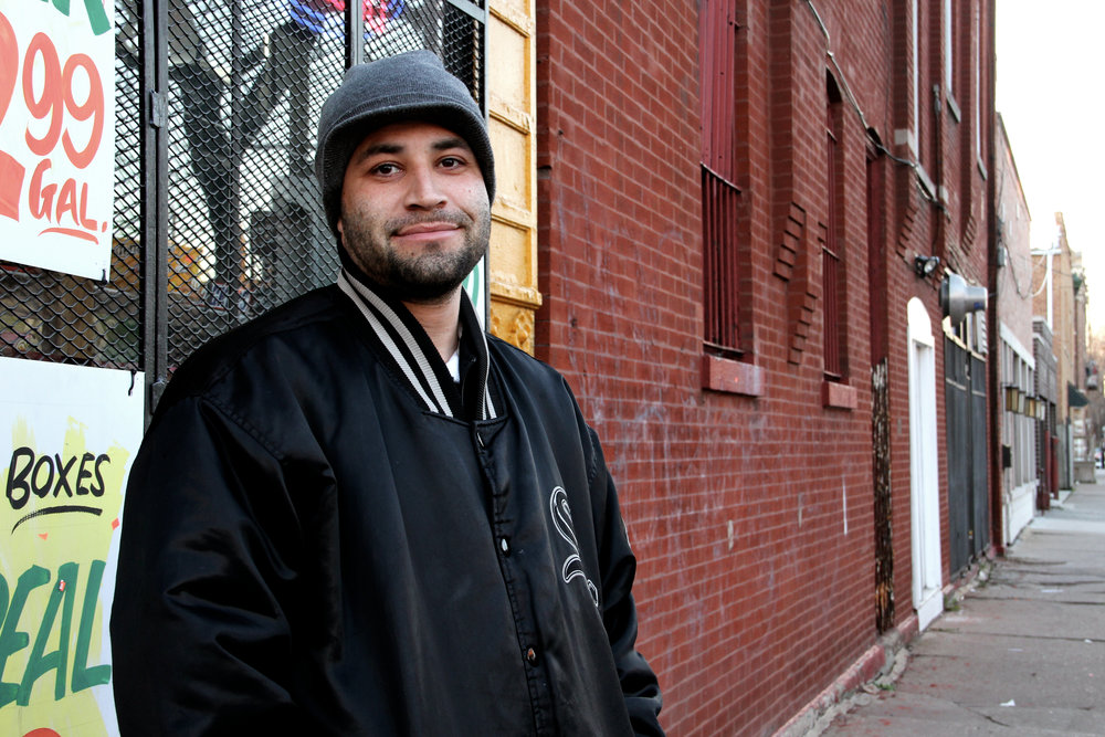 I was just outside of the corner store across the street from my apartment. I've seen him around before, and he told me he works in the barber shop next door. Neither one of us had a pen, but I gave him my business card and promised to e-mail him back with the photo if he sent me a message. He never did, but when I was walking back home hours later, I passed the barber shop window. He smiled and waved at me through the glass.