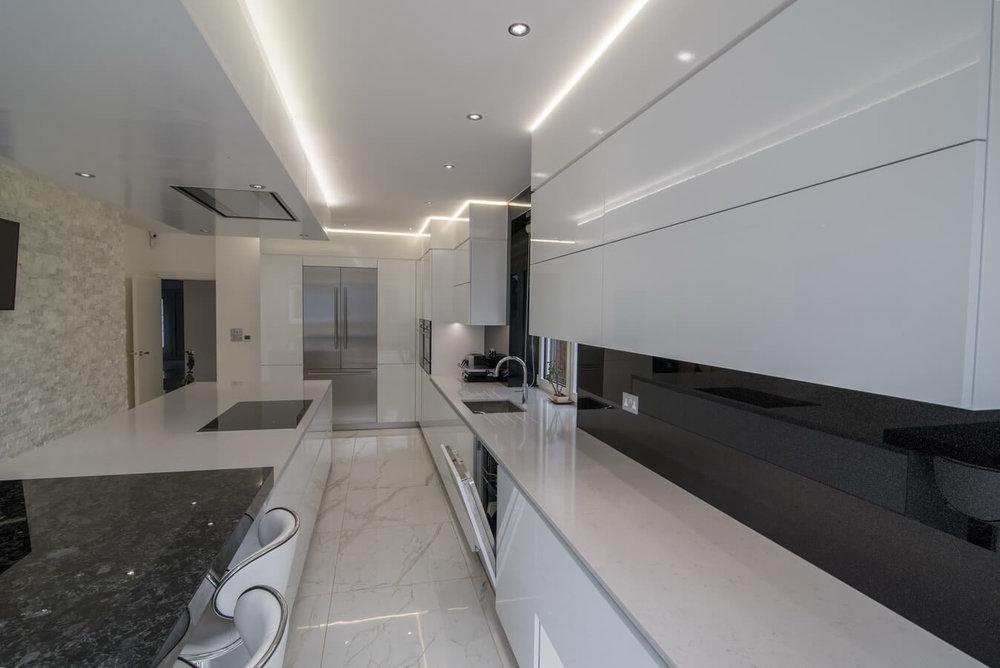white-gloss-german-kitchen-cabinets-by-schuller.jpg