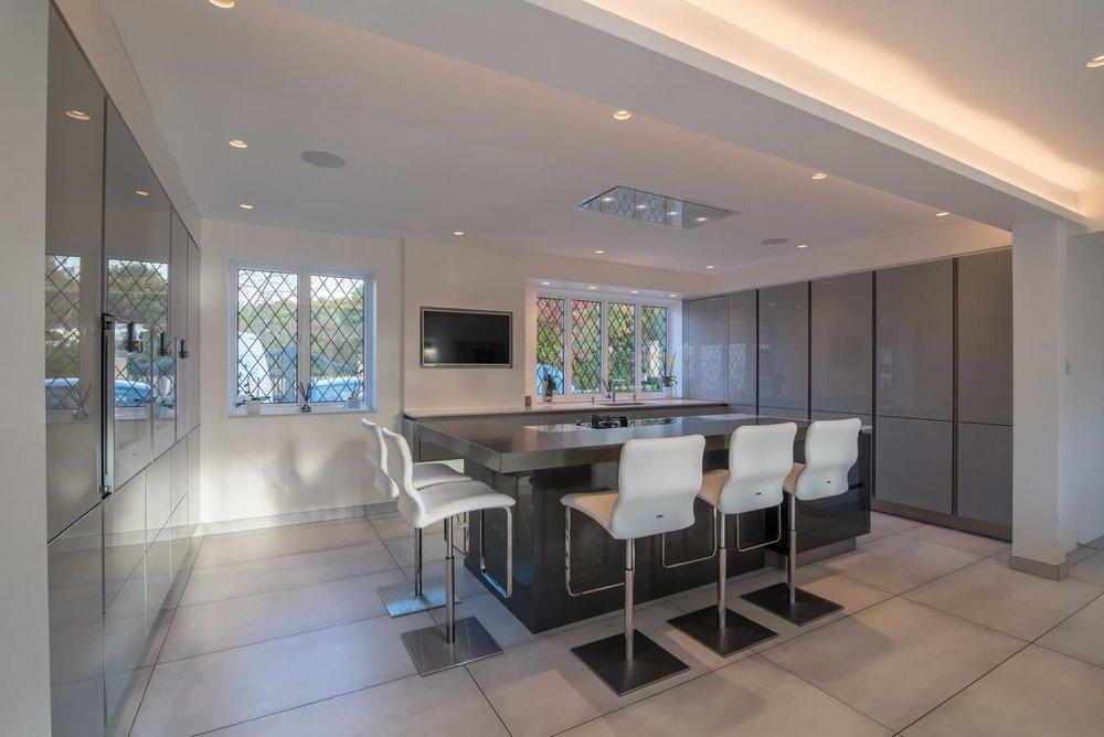 glossy-grey-glass-german-kitchen.jpg