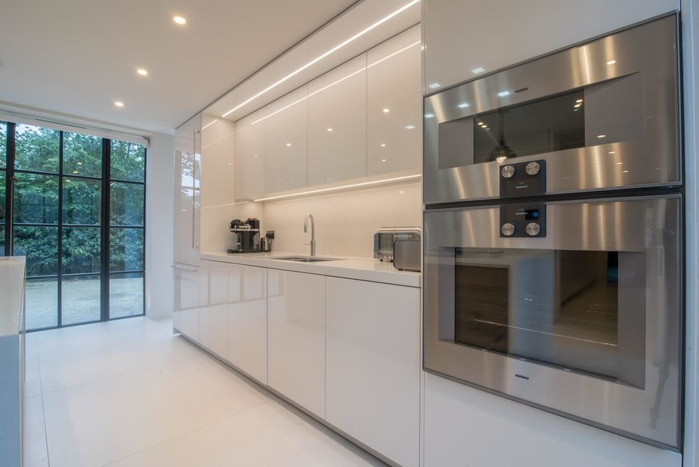 Glossy-White-Handleless-Kitchen-London.jpg