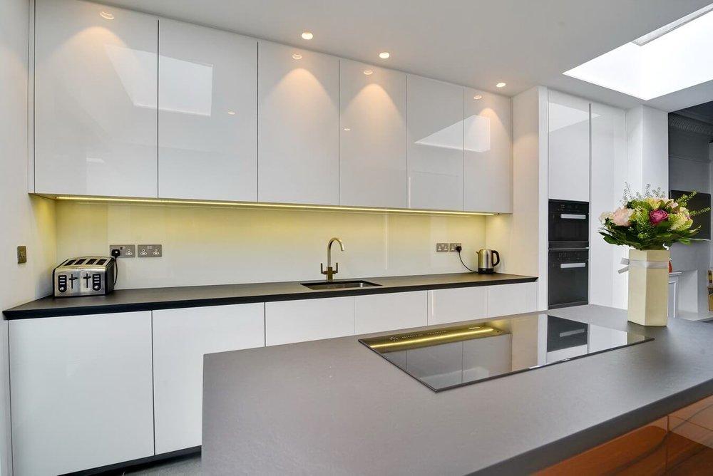 White-German-Fitted-Kitchen-Dekton-Worktop.jpg