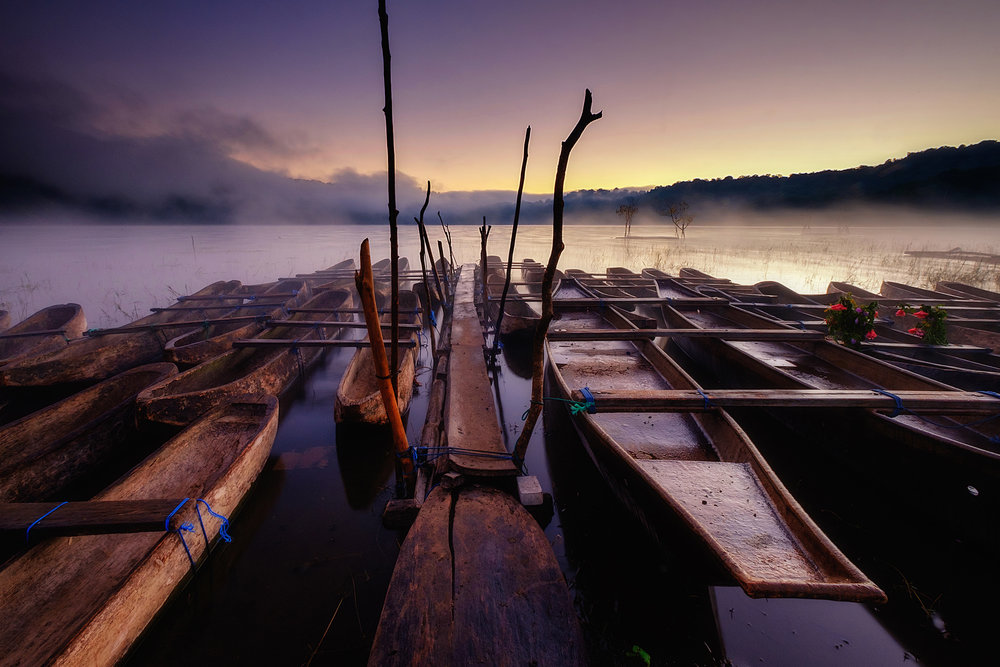 Tamblingan   Dugout canoes at Tamblingan lake at dawn, Central Bali.