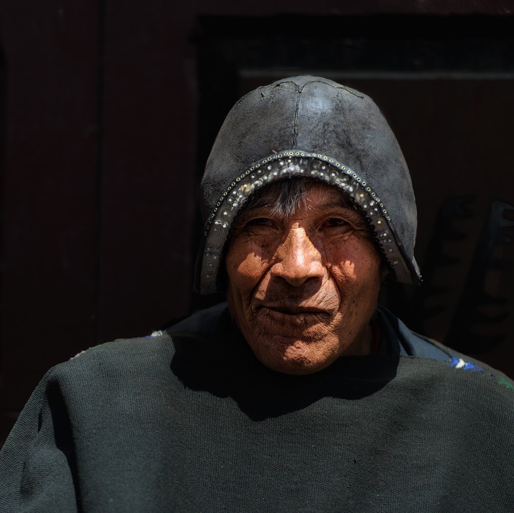 Tarabuco   La Paz is filled with local people from the indiginous tribes of the surrounding area.  I captured this image of a Tarabuco man wearing his traditional hat as he sat on a street corner in La Paz
