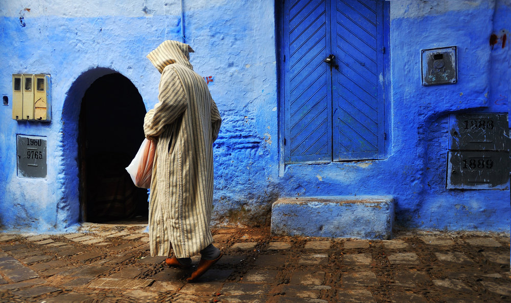 Morning in the Blue Town       A man walks through the medina, early morning in Chefchaouen