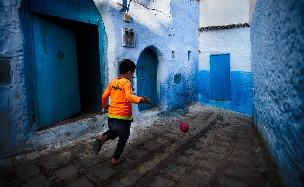 The Blue Town   A boy runs down the street chasing his football in the blue town of Chefchaouen in Morocco's Rif mountains.