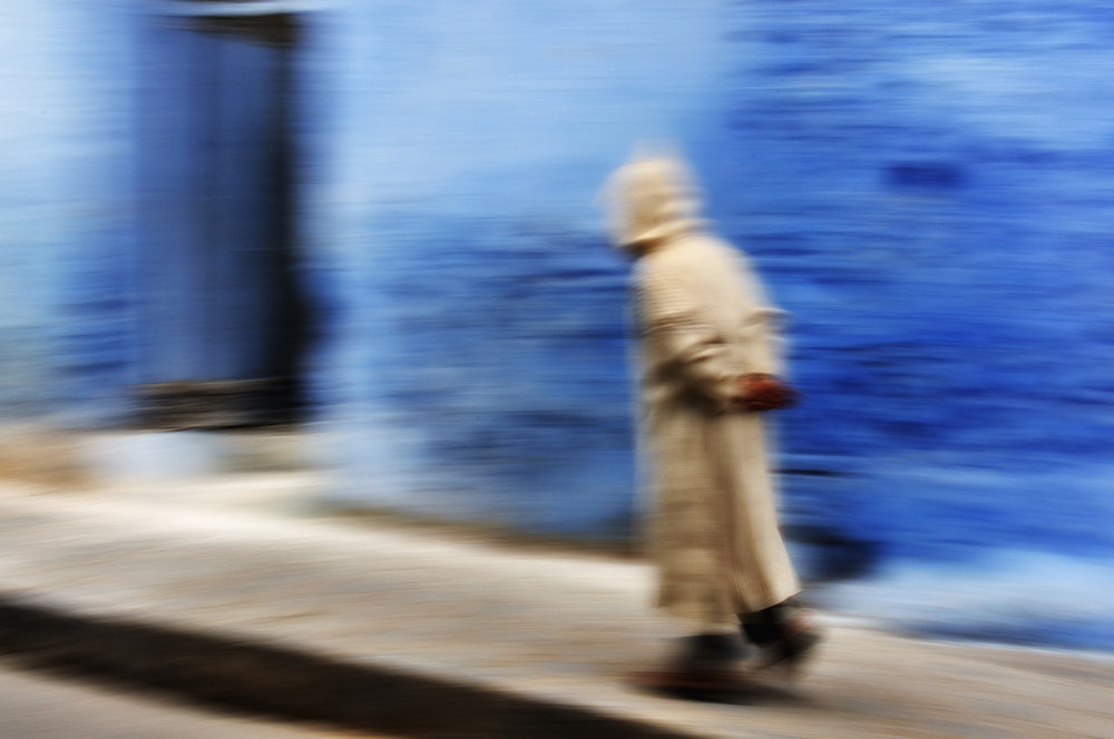 Chefchaouen A panning shot as a man walks through the blue town of Chefchaouen.