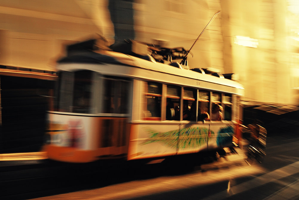 Electrico   A panning shot of Lisbon's famous 28 tram in late afternoon light.