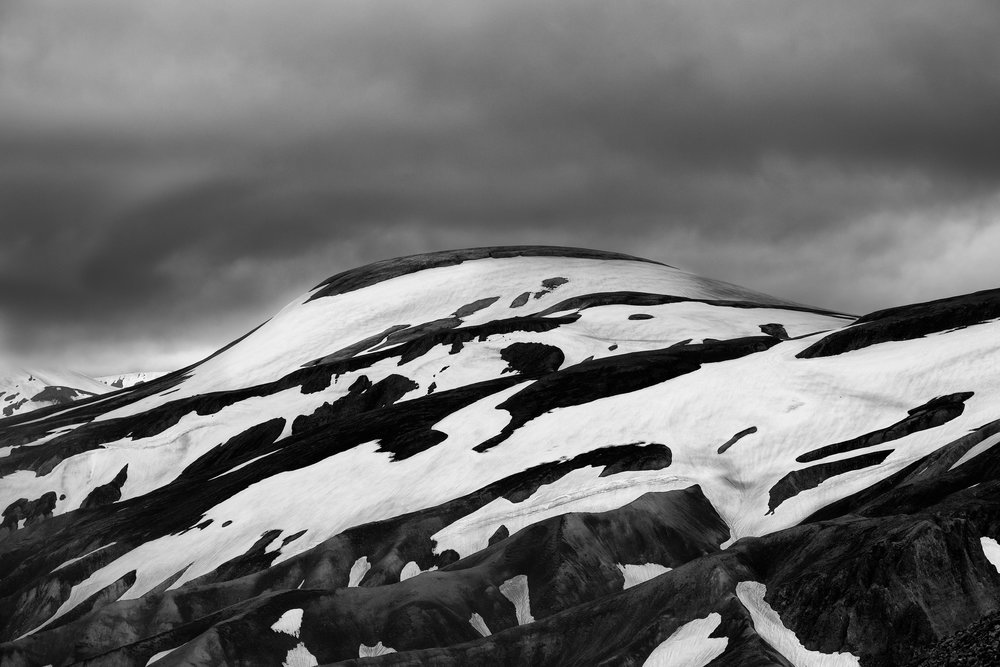 Landmannalaugar Peaks Snow covering the rhyolite peaks in Landmannalaugar create an abstract landscape when seen from the top of Blahnukur in the Icelandic highlands